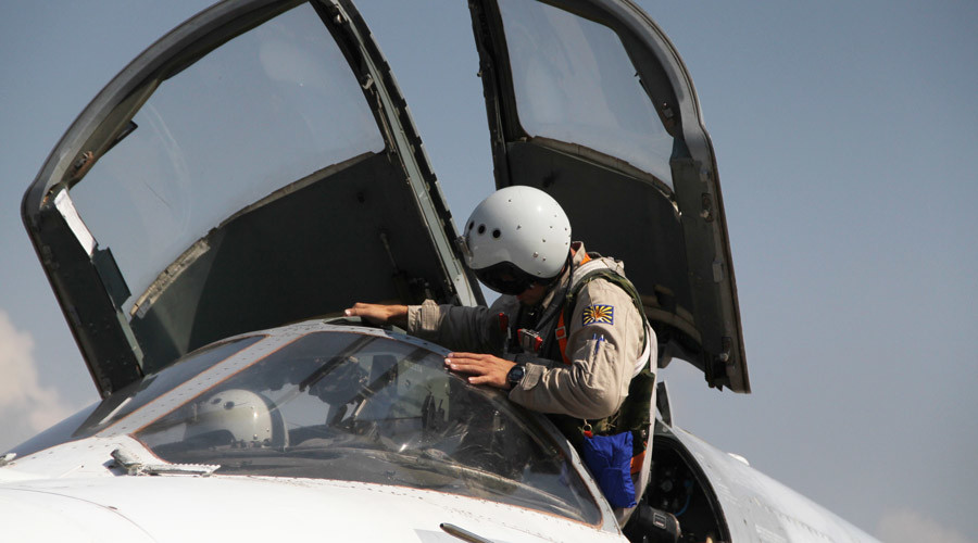 A Russian pilot gets into a Su-24 aircraft before taking off at the Khmeimim airbase in Syria. © Dmitriy Vinogradov