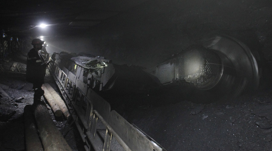 Miners work in a Komsomolskaya coal mine. © Eduard Korniyenko