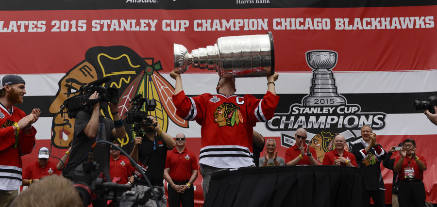 Chicago Blackhawks center Jonathan Toews (19) kisses the Stanley Cup trophy as he brings it into the rally during the 2015 Stanley Cup championship rally at Soldier Field. © Matt Marton