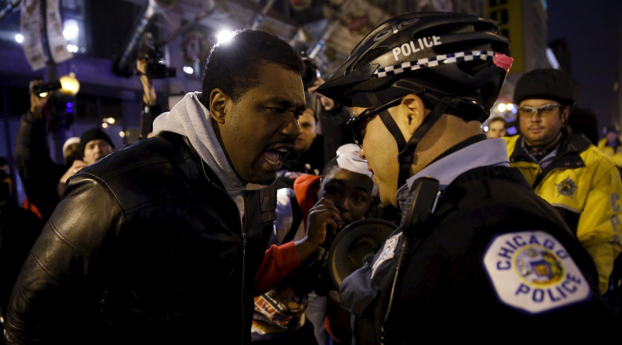 Protestors including Quovadis Green (L) confront police during a demonstration in response to the fatal shooting of Laquan McDonald in Chicago, Illinois November 25, 2015. © Andrew Nelles