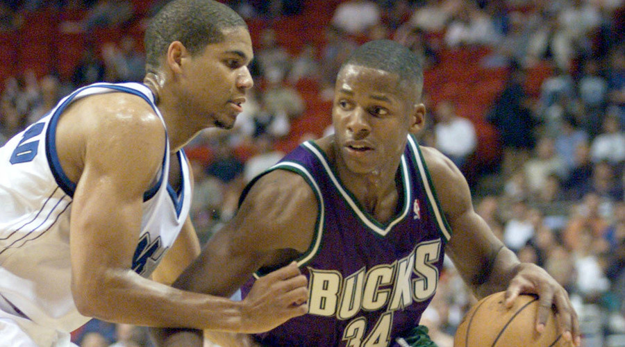 Milwaukee Bucks guard Ray Allen (R) brings the ball down court against Orlando Magic guard Tariq Abdul-Wahad (L) ©