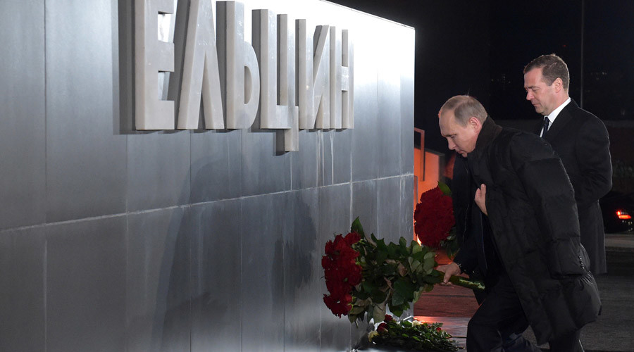Russian President Vladimir Putin, foreground, and Prime Minister Dmitry Medvedev at the ceremony to lay flowers at the memorial for first President of Russia Boris Yeltsin in Yekaterinburg. © Alexander Astafyev