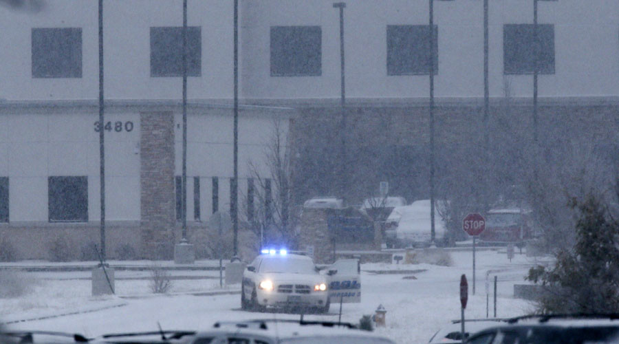 A police vehicle is seen left with the doors open at a Planned Parenthood center at 3480 Centennial Boulevard after reports of an active shooter in Colorado Springs, Colorado November 27, 2015. © Isaiah J. Downing