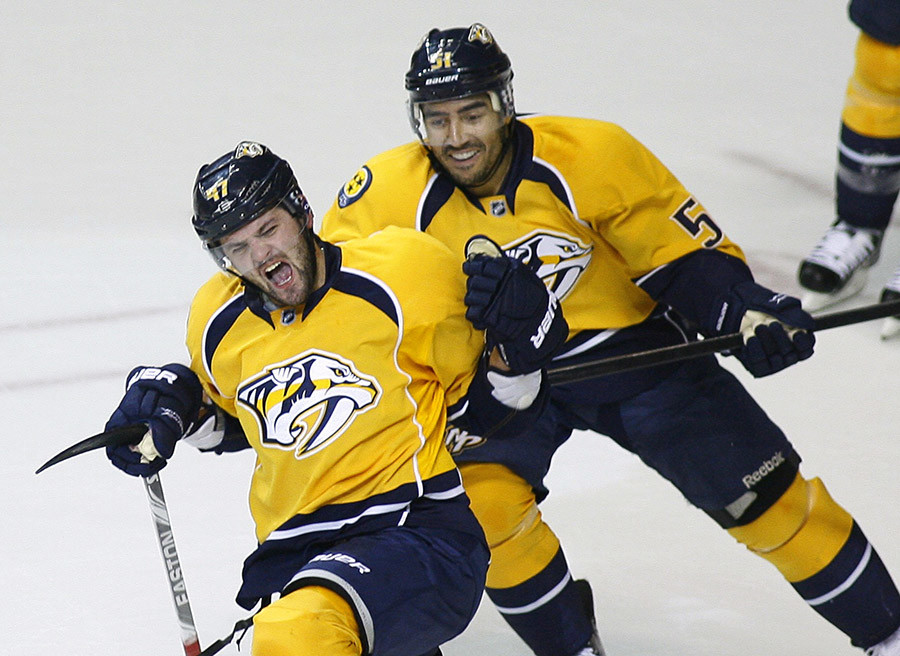 Nashville Predators' Alexander Radulov (L) celebrates his goal against the Detroit Red Wings with his teammate Francis Bouillon in Nashville, Tennessee April 20, 2012. © M.J. Masotti JR
