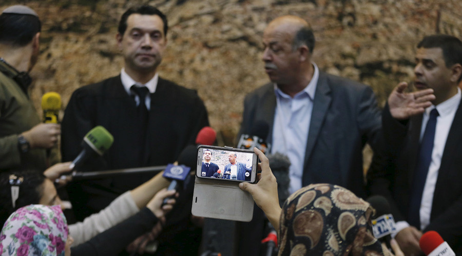Hussein Abu Khudair (2nd R), the father of murdered Palestinian teenager Mohammed Abu Khudair, talks to the media at the Jerusalem District Court November 30, 2015. © Ammar Awad