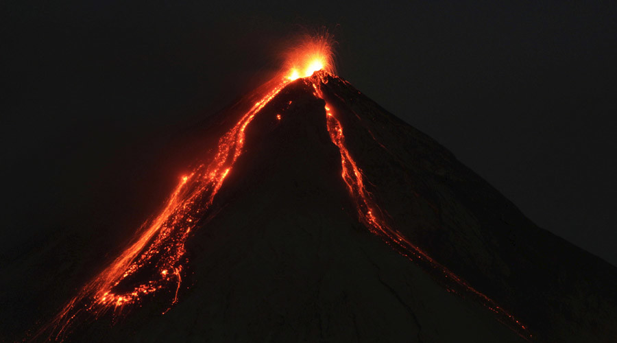 ARCHIVE IMAGE: Lava flows from Fuego volcano during an eruption as seen from Alotenango, Guatemala © Josue Decavele