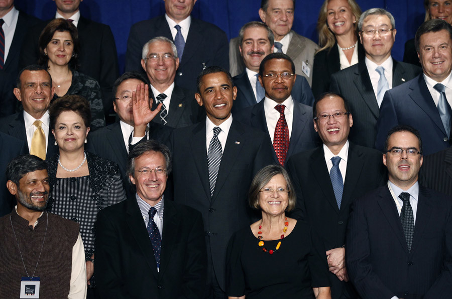 U.S. President Barack Obama waves during a family photo with leaders attending the Open Government Partnership event 