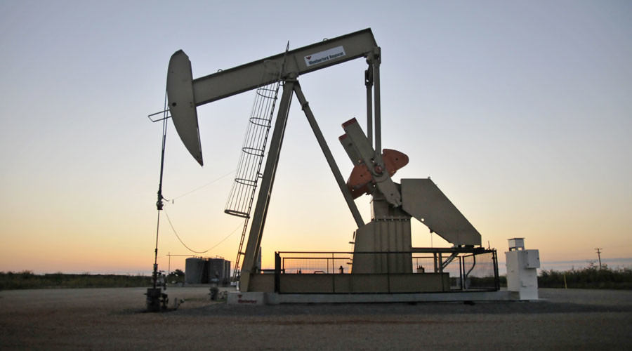 A pump jack operates at a well site leased by Devon Energy Production Company near Guthrie, Oklahoma. ©Nick Oxford
