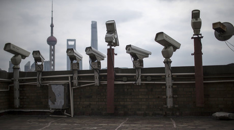 Security cameras are seen on a building at the Bund in front of the financial district of Pudong in Shanghai March. © Aly Song