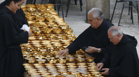 Ceremonial chalices are prepared before the canonisation ceremony of Popes John XXIII and John Paul II to start in St. Peter's Square at the Vatican April 27, 2014. © Stefano Rellandini