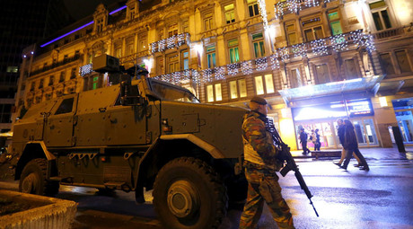 A Belgian soldier patrols near an armoured vehicle in central Brussels November 22, 2015, after security was tightened in Belgium following the fatal attacks in Paris. © Yves Herman