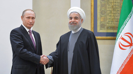 Russian President Vladimir Putin, left, and President of the Islamic Republic of Iran Hassan Rouhani at a news conference following Russian-Iranian talks in Tehran. © Alexei Druzhinin