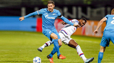 Olympique Lyon's Henri Bedimo (C) challenges Zenit St. Petersburg's Javi Garcia (L) during their Champions League Group H soccer match in Lyon, France, November 4, 2015. © Robert Pratta