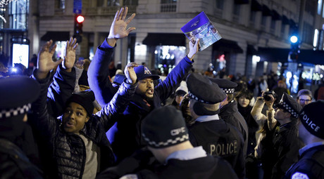 Demonstrators confront police officers during a protest in reaction to the fatal shooting of Laquan McDonald in Chicago, Illinois, November 27, 2015. ©Andrew Nelles