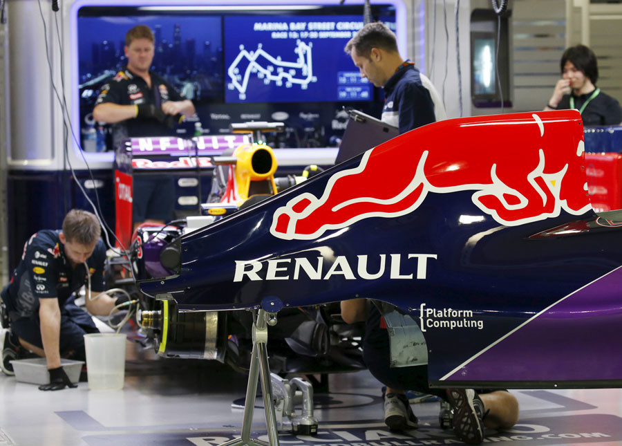 Red Bull Formula One crew work in the team garage after the third practice session of the Singapore F1 Grand Prix at the Marina Bay street circuit September 19, 2015. ©Edgar Su