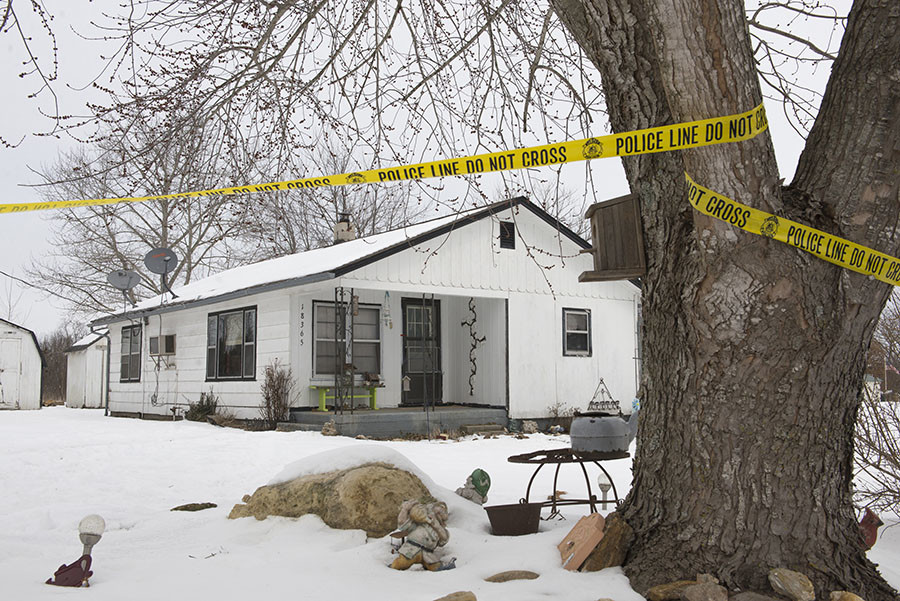 Police tape surrounds one of the crime scenes where gunman, Joseph Jesse Aldridge, killed seven people on Thursday night in Tyrone, Missouri February 27, 2015. © Kate Munsch