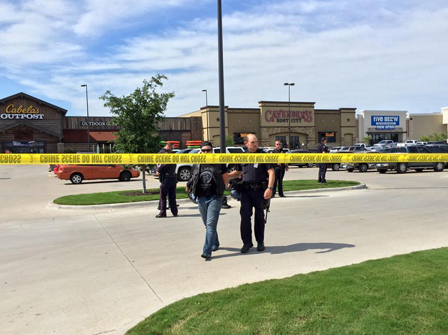 Police escort a man at the scene of a shooting in Waco, Texas, in this handout photo provided by the Waco Police Department on May 17, 2015. © /Waco Police Department