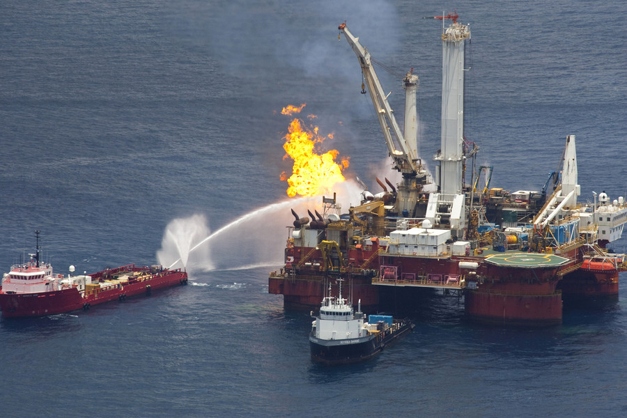 Natural gas is burned off a support vessel above the source of Deepwater Horizon oil spill where BP will begin testing a new cap placed over the leak in the Gulf of Mexico off the Louisiana coast July 13, 2010. © Lee Celano