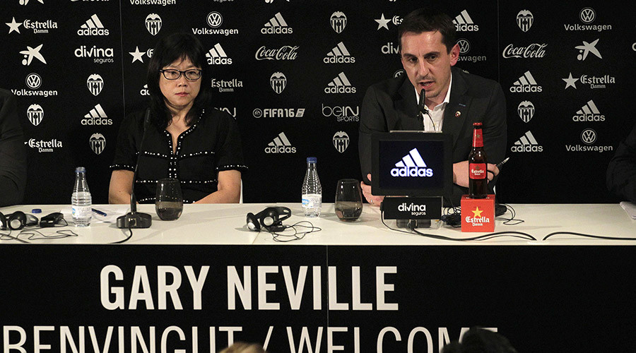 Valencia's new coach Gary Neville (R) attends a news conference next to the club's president Chan Lay Hoon during his presentation at the Mestalla stadium in Valencia, Spain, December 3, 2015. © Heino Kalis