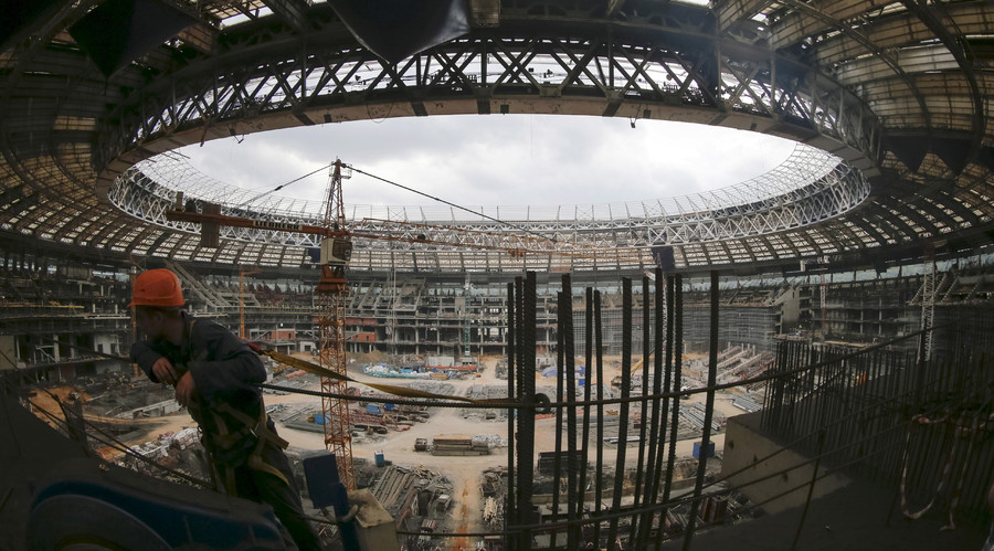 A construction worker rests inside the Luzhniki stadium under construction in Moscow, Russia, July 9, 2015. © Maxim Shemetov