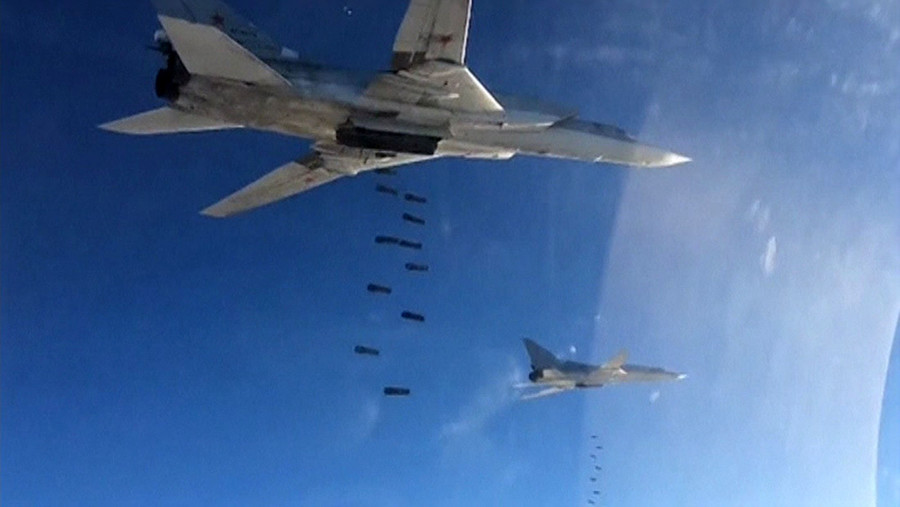 A still image taken from video footage, released by Russia's Defence Ministry on November 20, 2015, shows Russian Tupolev TU-22 long-range strategic bombers conducting an airstrike at an unknown location in Syria. © Ministry of Defence of the Russian Federation
