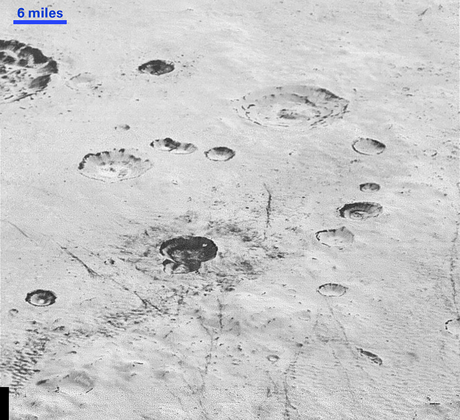 Layered Craters and Icy Plains: This highest-resolution image from NASA's New Horizons spacecraft reveals new details of Pluto's rugged, icy cratered plains, including layering in the interior walls of many craters. © NASA/JHUAPL/SwRI