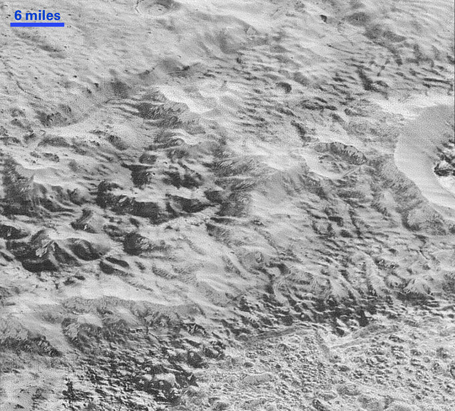 Pluto's 'Badlands': This highest-resolution image from NASA's New Horizons spacecraft shows how erosion and faulting have sculpted this portion of Pluto's icy crust into rugged badlands topography. © NASA/JHUAPL/SwRI