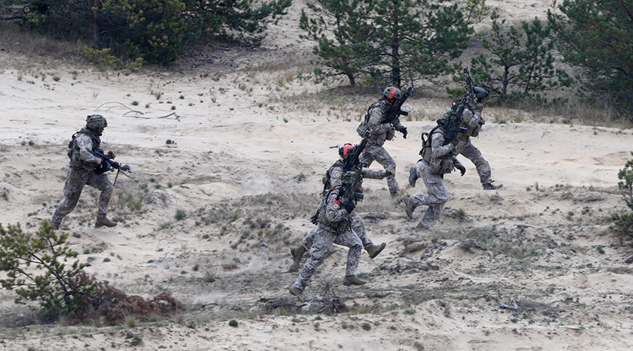 "NATO soldiers participate in ""Operation Hazel"" military drill at the Adazi training field, Latvia © Ints Kalnins"