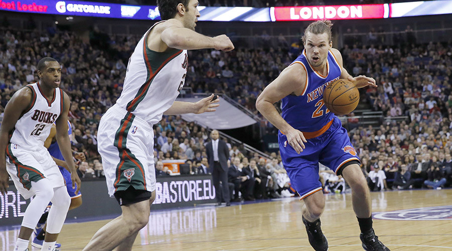 New York Knicks forward Lou Amundson (21) goes to the basket past Milwaukee Bucks center Zaza Pachulia (27) during their regular season NBA basketball game at the O2 Arena in London, January 15, 2015. © Suzanne Plunkett