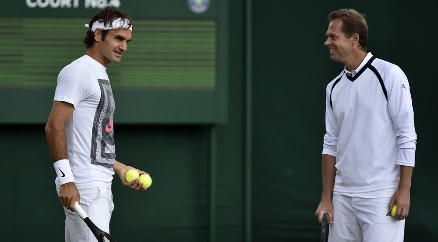 Roger Federer of Switzerland (L) speaks with his coach Stefan Edberg during a practice session at the Wimbledon Tennis Championships in London July 5, 2014. © Toby Melville