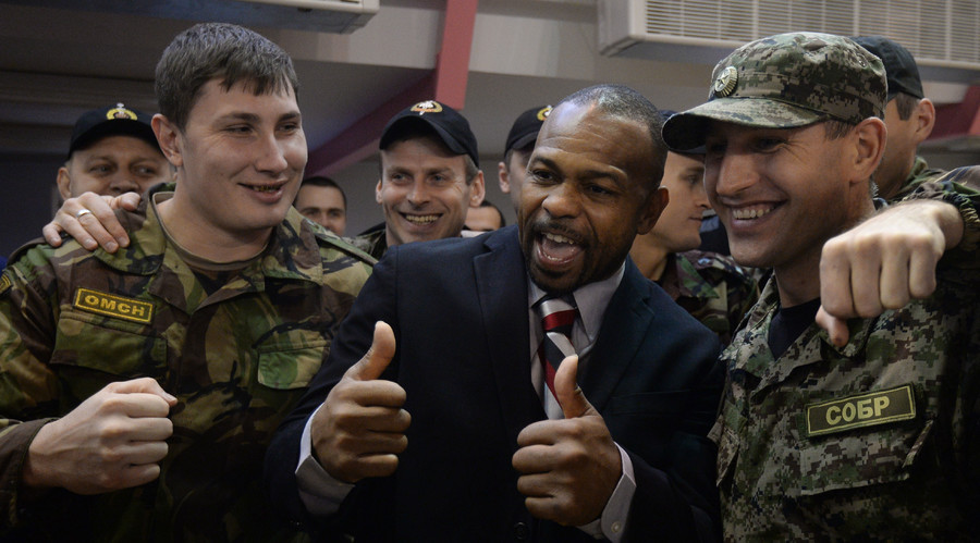 Boxer Roy Jones, center, poses for a photo after a training session for Moscow police officers at the sports center of the Public Safety Police Directorate for Moscow. © Alexey Filippov