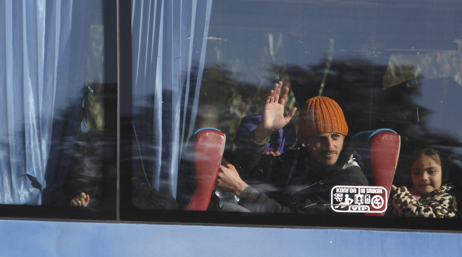 A man gestures as he looks out of the window in a bus leaving the district of Waer during a truce between the government and rebel fighters, in Homs December 9, 2015. © Omar Sanadiki