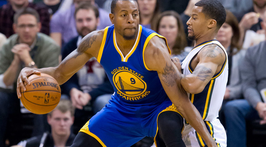 Utah Jazz guard Trey Burke (3) defends against Golden State Warriors forward Andre Iguodala (9) during the second half at Vivint Smart Home Arena. The Warriors won 106-103. Mandatory ©  Russ Isabella