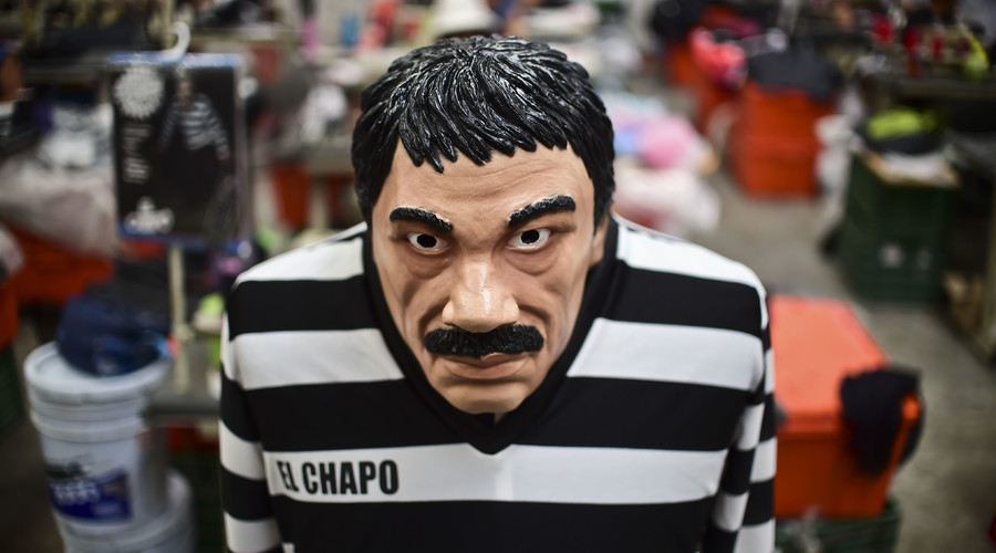 """A costume and a mask representing Mexican drug trafficker Joaquin Guzman Loera, aka """"El Chapo"""", are pictured in a factory of costumes and masks, on October 16, 2015, in Jiutepec, Morelos State. © Ronaldo Schemidt"""