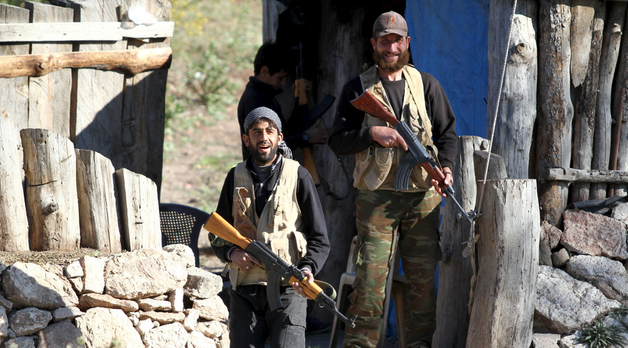 Syrian Turkmen fighters are seen near the northern Syrian village of Yamadi, near the Turkish-Syrian border, Syria, November 24, 2015. © Stringer
