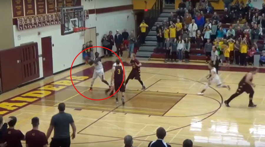 VIDEO: Teen basketball player makes 'one in a million shot'