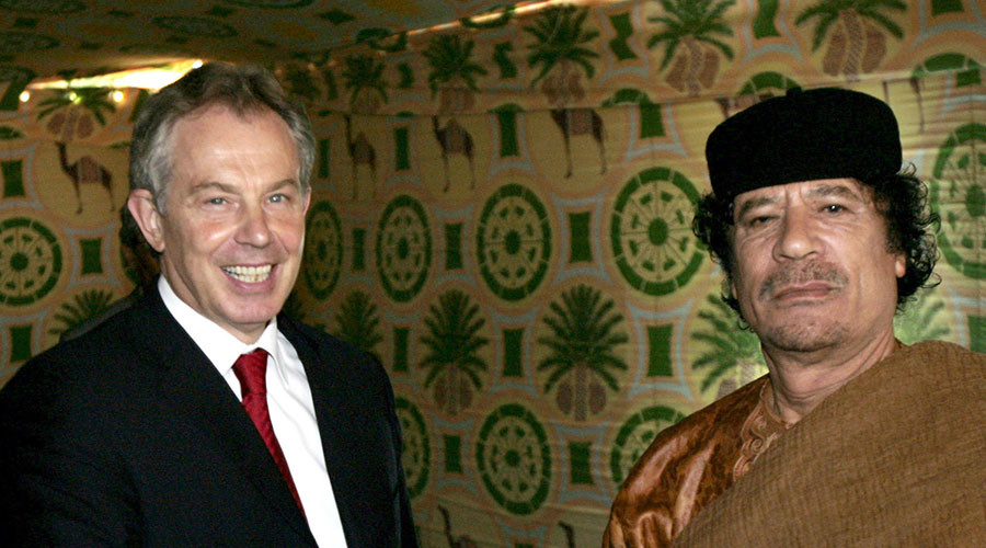 Britain's Prime Minister Tony Blair (L) with Libyan leader Muammar Gaddafi near Gaddafi's home town of Sirte May 29, 2007. © Leon Neal