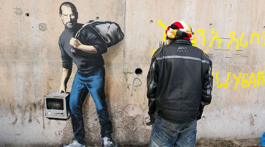 Banksy's 'Steve Jobs the Son of Syrian Migrant' pops up in Calais camp