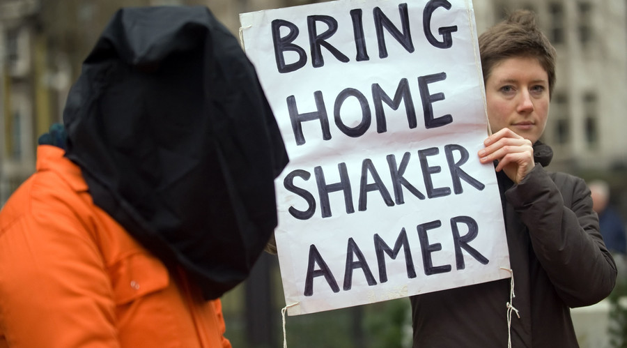 A protestor holds up a sign calling for the release of Shaker Aamer from the Guantanamo prison during a demonstration in central London. © Leon Neal