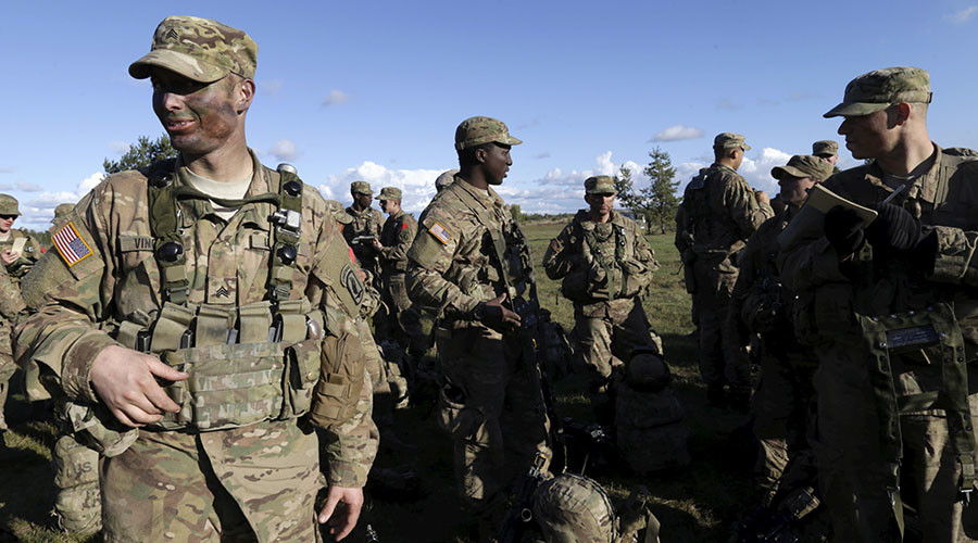 """U.S. Army soldiers rest during a break in the """"Silver Arrow 2015"""" NATO military exercise at a training field near Adazi, Latvia, September 27, 2015. ©Ints Kalnins"""