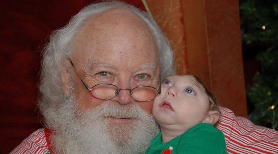 Miracle baby: Child born without most of brain meets Santa