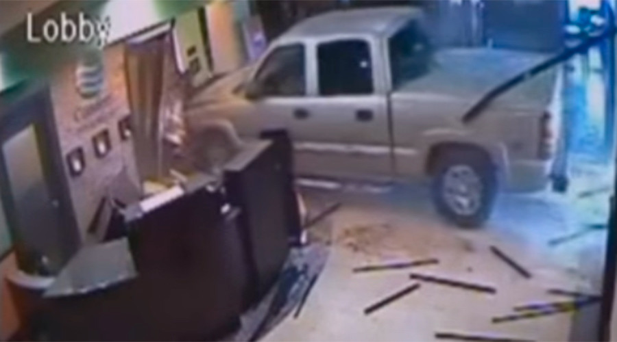 Angry man narrowly misses workers when driving into hotel lobby (VIDEO)