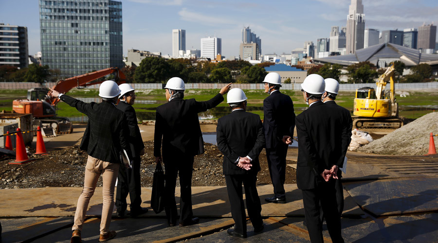 Japan Sport Council officials survey the site where the new national stadium, the centrepiece of the Tokyo 2020 Olympics, is to be built in Tokyo, November 16, 2015. © Thomas Peter