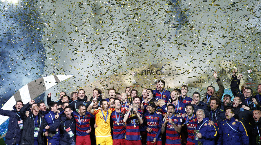 FC Barcelona celebrate winning the FIFA Club World Cup Final with the trophy © Thomas Peter