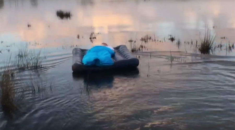 Practical joker drags sleeping friend's airbed into lake in cruel wakeup call (VIDEO)
