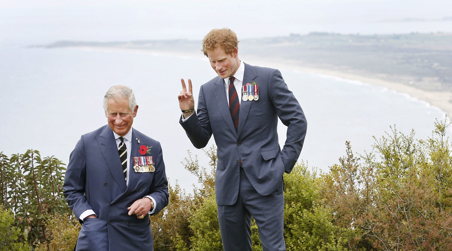 Britain's Prince Harry (L) poses next to Prince Charles, Prince of Wales. © David Caird
