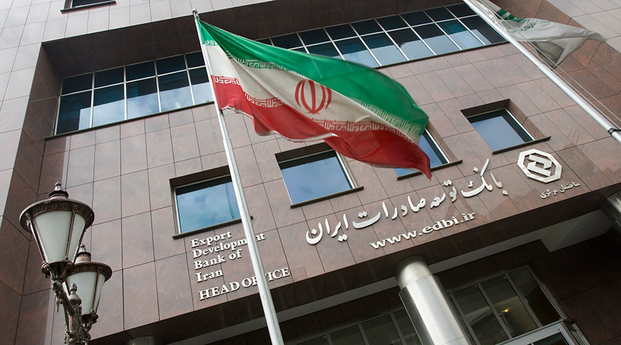 An Iranian flag flutters in front of the head office of the Export Development Bank of Iran (EDBI) in Tehran © Morteza Nikoubazl