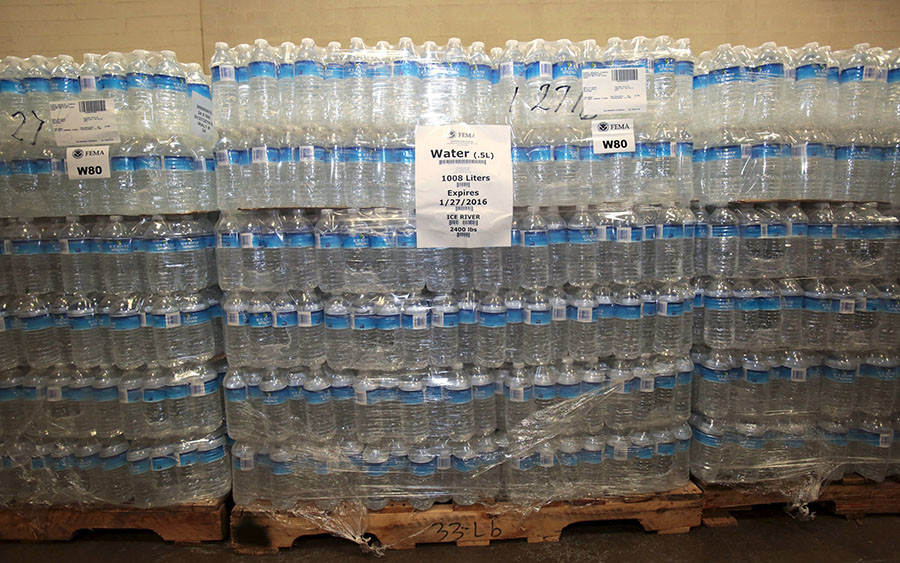 The Food Bank of Eastern Michigan holds stacks of bottled water in the agency's warehouse that will be distributed to the public, after elevated lead levels were found in the city's water, in Flint, Michigan. © Rebecca Cook
