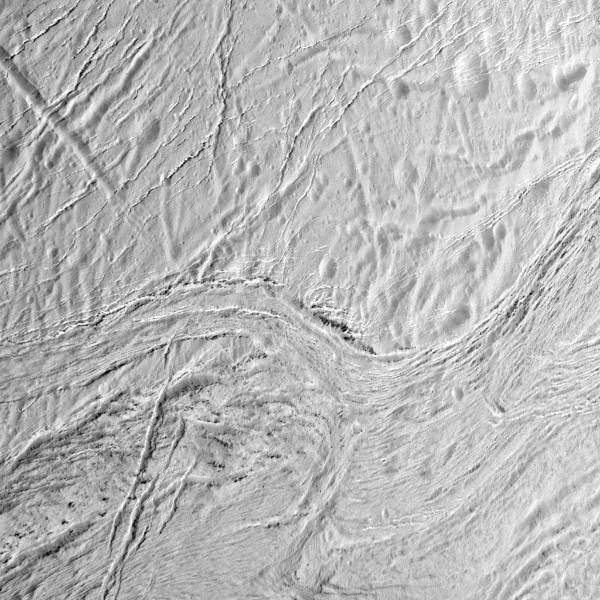 During its final close flyby of Saturn's moon Enceladus, NASA's Cassini spacecraft captured this view featuring the nearly parallel furrows and ridges of the feature named Samarkand Sulci