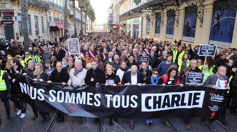 "People hold a banner reading ""Nous sommes tous Charlie"" (We are all Charlie) during a Unity rally ""Marche Republicaine"" on January 11, 2015 in Montpellier. © Sylvain Thomas"